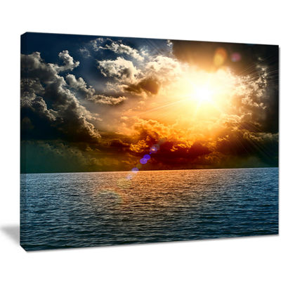 Designart Yellow Sunset In The Middle Of Ocean Canvas Art