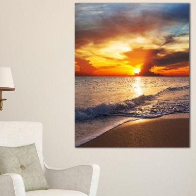 Designart Yellow Sunset Over Gloomy Beach Canvas Art
