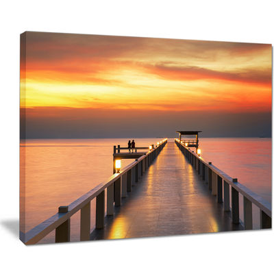 Designart Yellowish Sky And Long Wooden Bridge Canvas Art