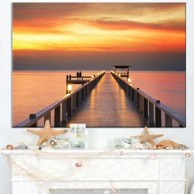 Designart Yellowish Sky And Long Wooden Bridge Canvas Art