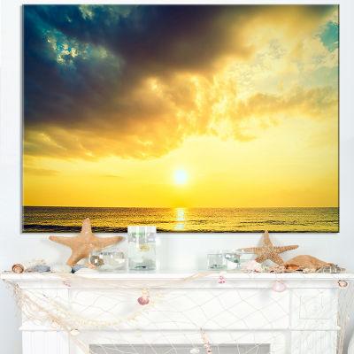 Designart Yellowish Sky Over Serene Seashore Canvas Art