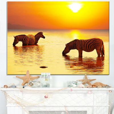 Designart Zebras Drinking In Lake At Sunset Canvas Art