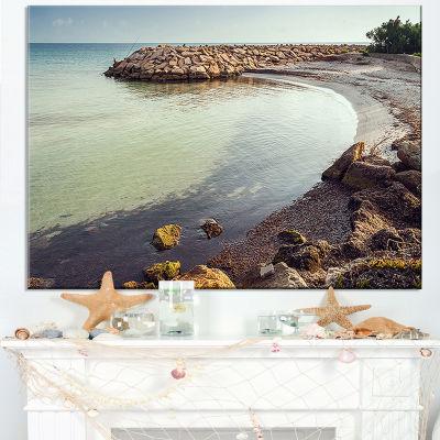 Designart Little Lagoon With Fishermen Africa Canvas Art