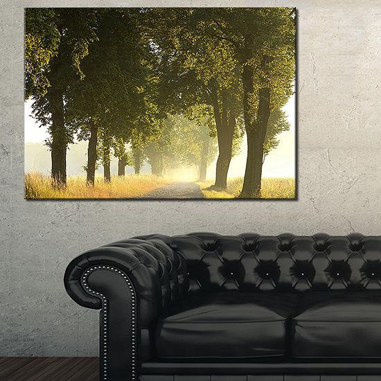 Designart Country Road Below Green Trees Canvas Art