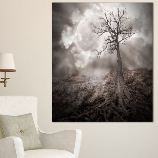 Designart Lonely Tree Holding The Moon Canvas Art