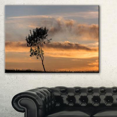 Designart Lonely Tree Silhouette Leftwards Canvas Art