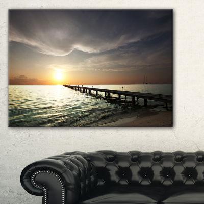 Designart Long Boardwalk In The Cloudy Dark Sea Canvas Art