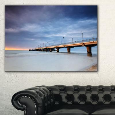 Designart Long Concrete Pier Into Sea Canvas Art