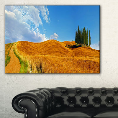 Designart Cypress Trees On Flowered Field Canvas Art