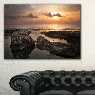 Designart Dark Africa Beach With Ancient Ruins Canvas Art