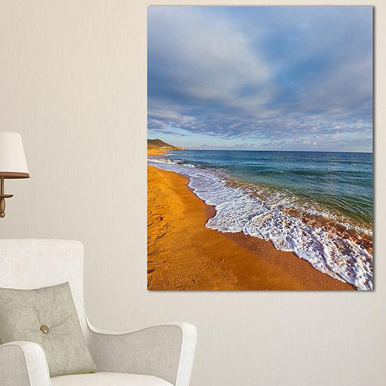 Designart Dark Beach Under Cloudy Skies Canvas Art