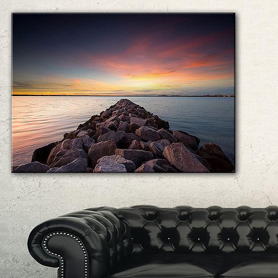 Designart Long Stone Bridge Into Beautiful Sea Canvas Art