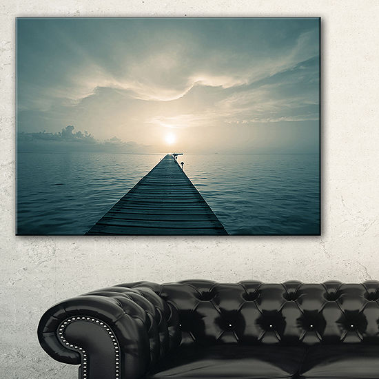 Designart Dark Boardwalk Into Blue Sea Canvas Art