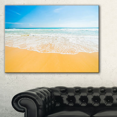 Designart Long Waves On Sand Under Blue Sky Canvas Art