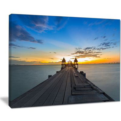 Designart Long Wood Pier Leading To Colorful Sea Canvas Art