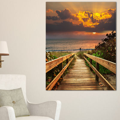 Designart Long Wooden Stairs Into The Sea Canvas Art
