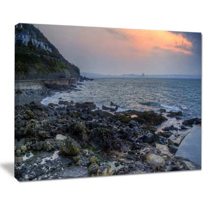 Designart Dark Rocky Seashore Sunrise Canvas Art