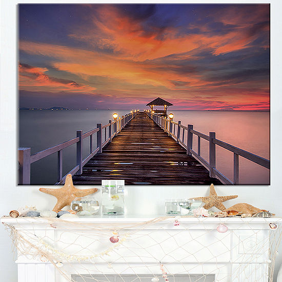 Designart Dark Seashore Pier Under Colorful Sky Canvas Art