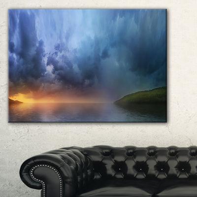 Designart Dense Blue Clouds Over Lake Canvas Art