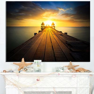 Designart Massive Wood Pier To Sun At Evening Canvas Art