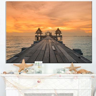 Designart Massive Wooden Bridge Into The Sea Canvas Art