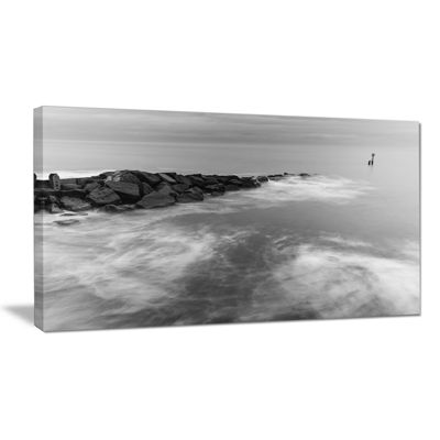 Designart Milky Waves Splashing Over Rocks Canvas Art
