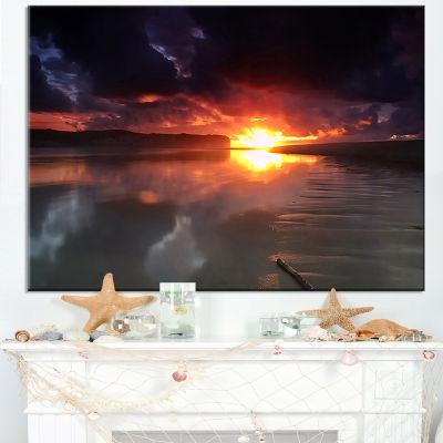 Designart Mirrored Sun In Cloudy Dark Seashore Canvas Art