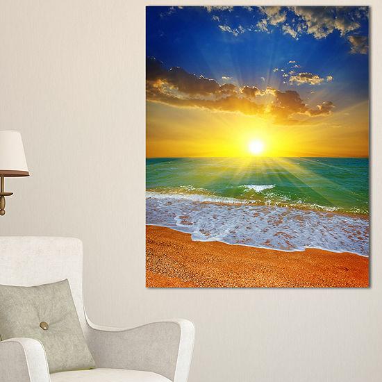 Designart Dramatic Seashore Sky In Yellow Canvas Art
