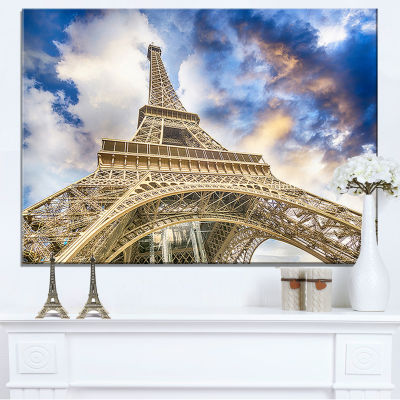 Designart Dramatic Sky Over Ground View Of Paris Paris Eiffel Tower Canvas Art