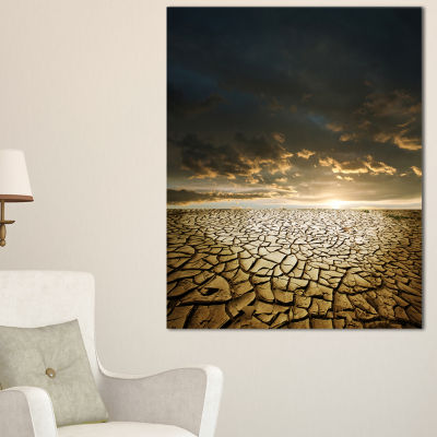 Designart Drought Land Under Cloudy Skies Canvas Art