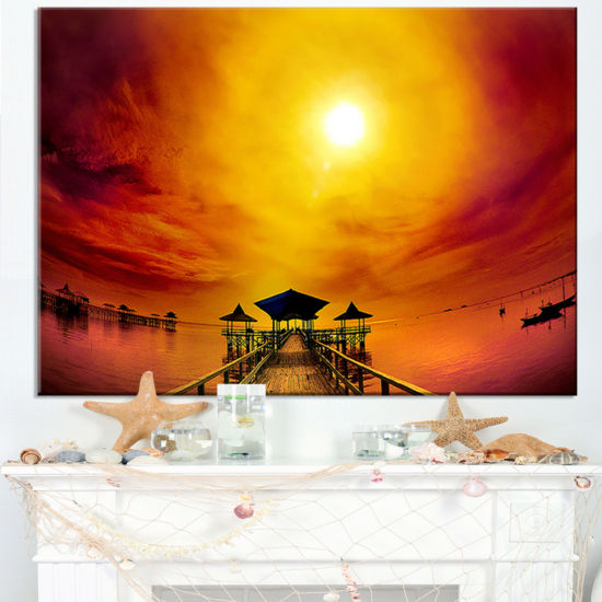 Designart Exotic Wood Pier Under Yellow Sun Canvas Art