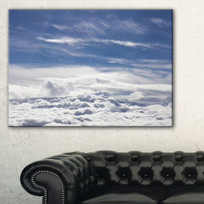 Designart Flight Over Bright Clouds Canvas Art
