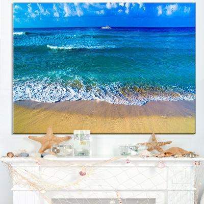Designart Floating Blue Waves Beach Canvas Art