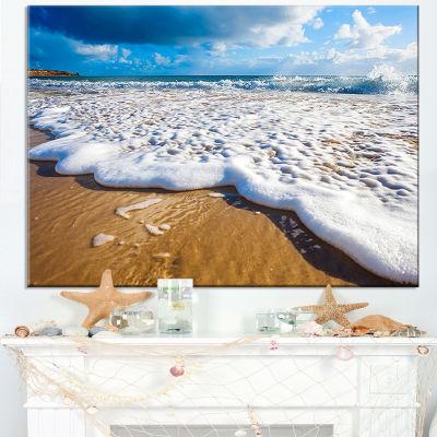 Designart Foaming Ocean Waves On Sand Canvas Art