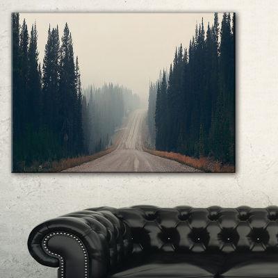 Designart Foggy Road In Forest In Banff Park Canvas Art