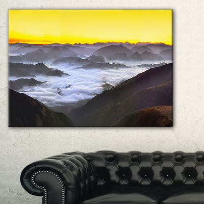 Designart Foggy Sunrise Over Mountains Canvas Art