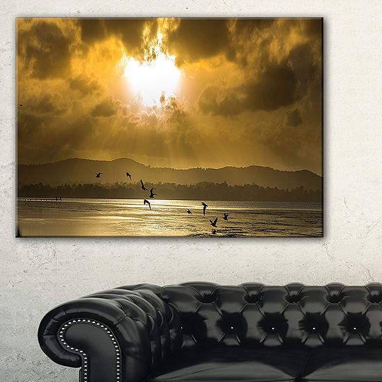Designart Glittering Sun Among Heavy Clouds Canvas Art