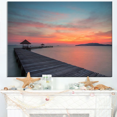Designart Gloomy Seashore With Long Wood Pier Canvas Art