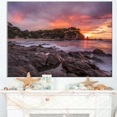 Designart Gloomy Seashore With Large Rocks Canvas Art