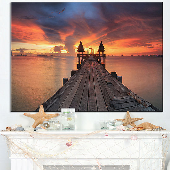 Designart Glowing Sky And Long Wooden Bridge Canvas Art