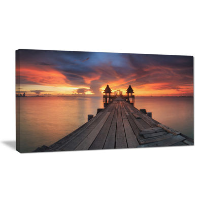 Designart Glowing Sky And Long Wooden Bridge Canvas Art