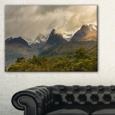 Designart Green Mountains Under Stormy Clouds Canvas Art
