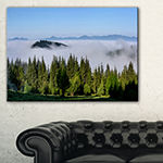 Designart Green Trees And Fog Over Mountains Canvas Art