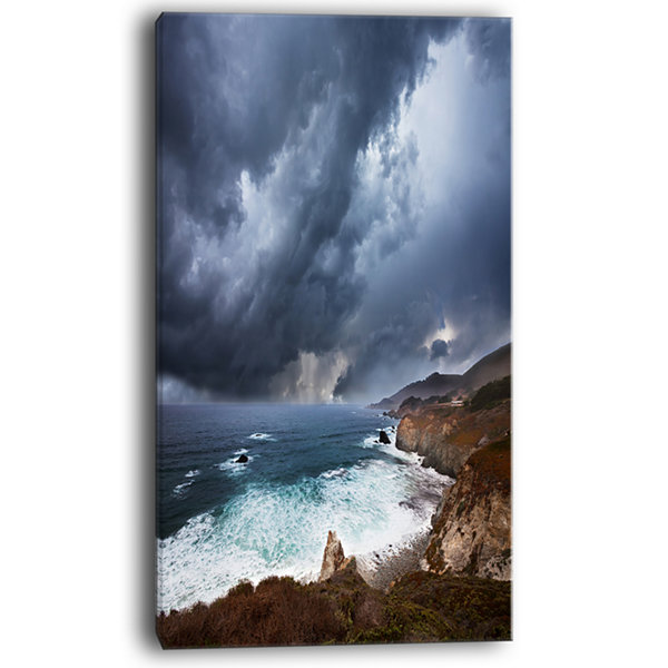 Designart Heavy Blue Clouds And Waves Canvas Art
