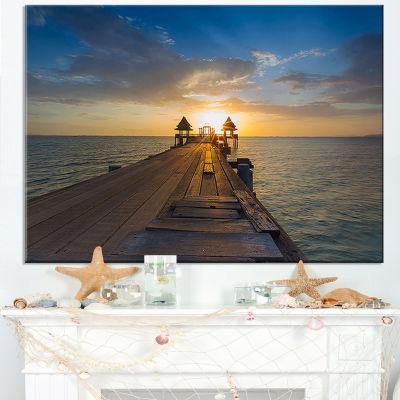 Designart Huge Wooden Pier Into Setting Sun Canvas Art