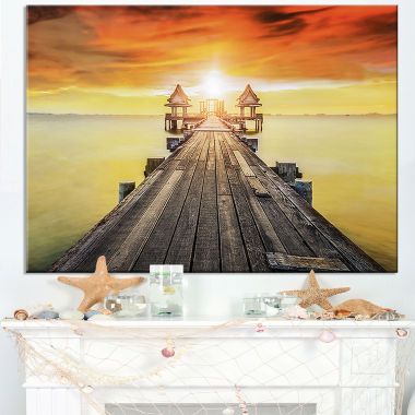 Designart Huge Wooden Pier Into Yellow Sun Canvas Art
