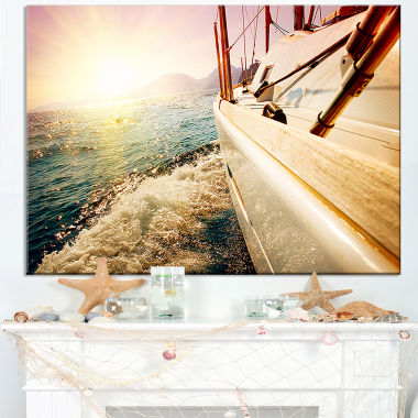 Designart Huge Yacht Sailing Against Sunset Canvas Art