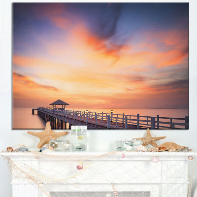 Designart Infinite Wooden Bridge Under Clouds Canvas Art