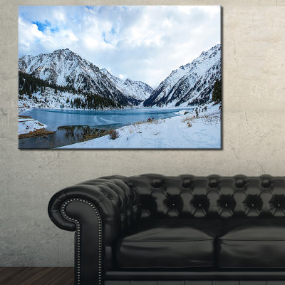 Designart Lake Between Foggy Mountains Canvas Art