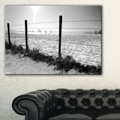Designart Landscape In Snow With Fence Canvas Art